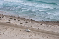 Car at the coast of ocean. Socotra island Royalty Free Stock Image