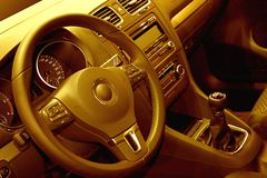 Car Cockpit. Yellow toned interior of a modern car Royalty Free Stock Photography