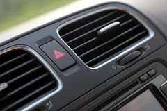 Car cockpit detail. Car air condition system fan close-up. Shallow DOF Royalty Free Stock Images