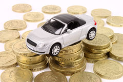 Car & Coins. A general metaphor for car finance, sale, debt, expenses and costs Royalty Free Stock Photography
