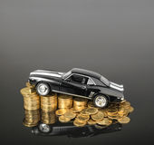 Car on coins with copyspace Royalty Free Stock Image