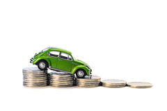 Car on coins. Car on the coins isolated on white background Stock Images
