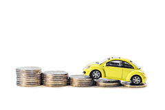 Car on coins. Car on the coins isolated on white background Royalty Free Stock Photos
