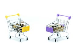 Car and coins in shopping cart,auto loan concept. Car and coins in shopping cart,auto loan concept royalty free stock photos