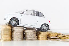 Car on coins Royalty Free Stock Image