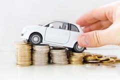 Car on coins Stock Photos