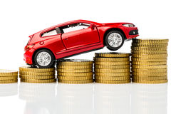 Car with coins Royalty Free Stock Photography
