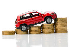 Car with coins Royalty Free Stock Photo