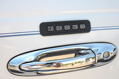 Car combination lock. Over a door handle royalty free stock image
