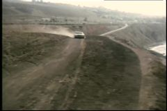 Car coming to a stop on seaside mountain top stock footage