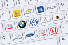 Car company logos like Mercedes, GM, VW, Porsche, Ford and Toyot. Berlin, Germany - April 7, 2015: Collection of logos of car companies like Mercedes, GM, VW Royalty Free Stock Images