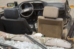 Car completely destroyed with broken glass Stock Photo