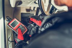 Car Computer Error Reading. Auto Service Diagnostic Tool in Hands of Vehicle Maintenance Worker. Car Computer Error Reading Using Mobile Device stock photography