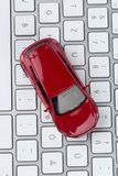 Car on computer keyboard Stock Images