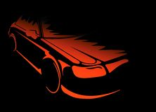 Car concept. Red car comes from the darkness Stock Photos