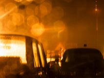 Car congestion in the big city. Ccumulation of cars in the evening in the light of lanterns Stock Photos