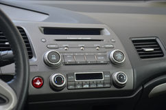 Car console. With climatization control, car radio and music control Royalty Free Stock Image