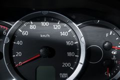 Car console with Speed Guage and Fuel Guage. Close up with Light beam Stock Photography