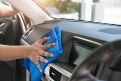 Car consoles, car interior cleaners, microfiber and how to clean Royalty Free Stock Photography