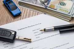 Car contract form, pen  dollar. Car contract form, pen and dollar Stock Photo