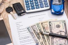 Car contract toy car, dollar calculator, pen pencil Stock Image