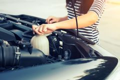 Car coolant checking. Women checking coolant level of car Stock Photography