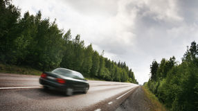 Car on a country road Royalty Free Stock Images
