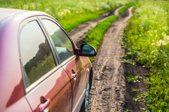 car on country road in meadow Stock Images