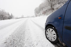 Car on a country road in winter Stock Photos