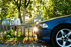 Car in countyside. Car on the road near the house Royalty Free Stock Images