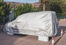 Car with cover Royalty Free Stock Photography