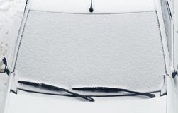 Car cover after snowfall Royalty Free Stock Images