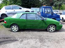 Car covered with artificial turf Stock Photo