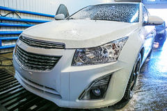 Car covered with foam in car wash Stock Photos