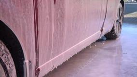 Car covered with foam. Car covered with foam for washing