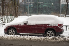 Car covered with fresh white snow. Royalty Free Stock Image