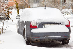 Car is covered icicles, snow and ice. Cleaning of snowdrift. Access problems. Stock Image