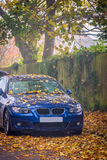 Car covered in leaves in autumn Royalty Free Stock Photos