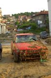 Car covered mud flooding Varna Bulgaria. These are the consequences of record rain that poured over the city of Varna on June 19th, 2014.tidal wave of tons of Royalty Free Stock Image