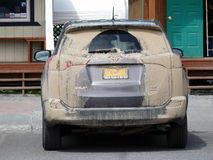 A car covered in mud at jade city, canada Royalty Free Stock Image