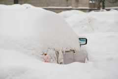 Car covered with snow Stock Images