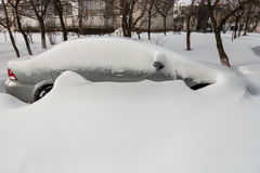 Car covered in snow Royalty Free Stock Image
