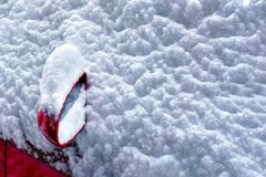 Car covered with snow in blizzard at winter Royalty Free Stock Photography