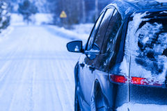Car covered with snow on a dangerous road. Stock Image