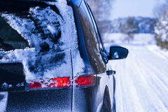 Car covered with snow on a dangerous road. Royalty Free Stock Images