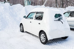 Car covered with snow Stock Photos
