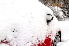 Car covered with snow in the parking Royalty Free Stock Photography
