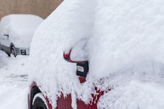 Car covered with snow in the parking Royalty Free Stock Photos