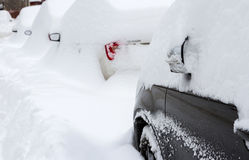 Car covered with snow in the parking Royalty Free Stock Images