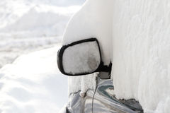 Car covered with snow in the parking Stock Images